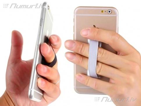 Turētājs pirkstiem, kurš piestiprinās ar divpusēja